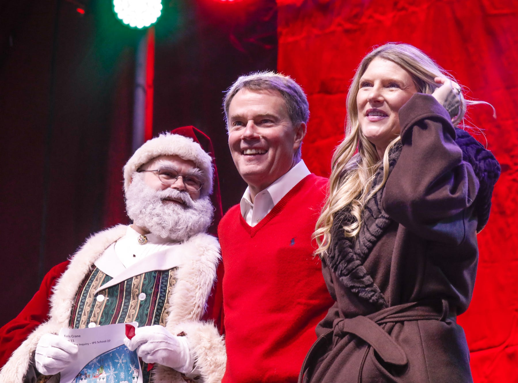 Indianapolis Mayor Joe Hogsett and his wife Stephanie are greeted on stage by Santa during the 2018 2018 Downtown Indy Circle of Lights ceremony,, held on Monument Circle in Indianapolis on Friday, Nov. 23, 2018.