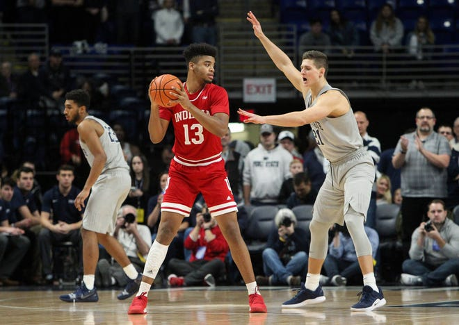 Dec 4, 2018; University Park, PA, USA; Indiana Hoosiers forward Juwan Morgan (13) holds the ball against Penn State Nittany Lions forward John Harrar (21) during the first half at Bryce Jordan Center. Mandatory Credit: Matthew O'Haren-USA TODAY Sports