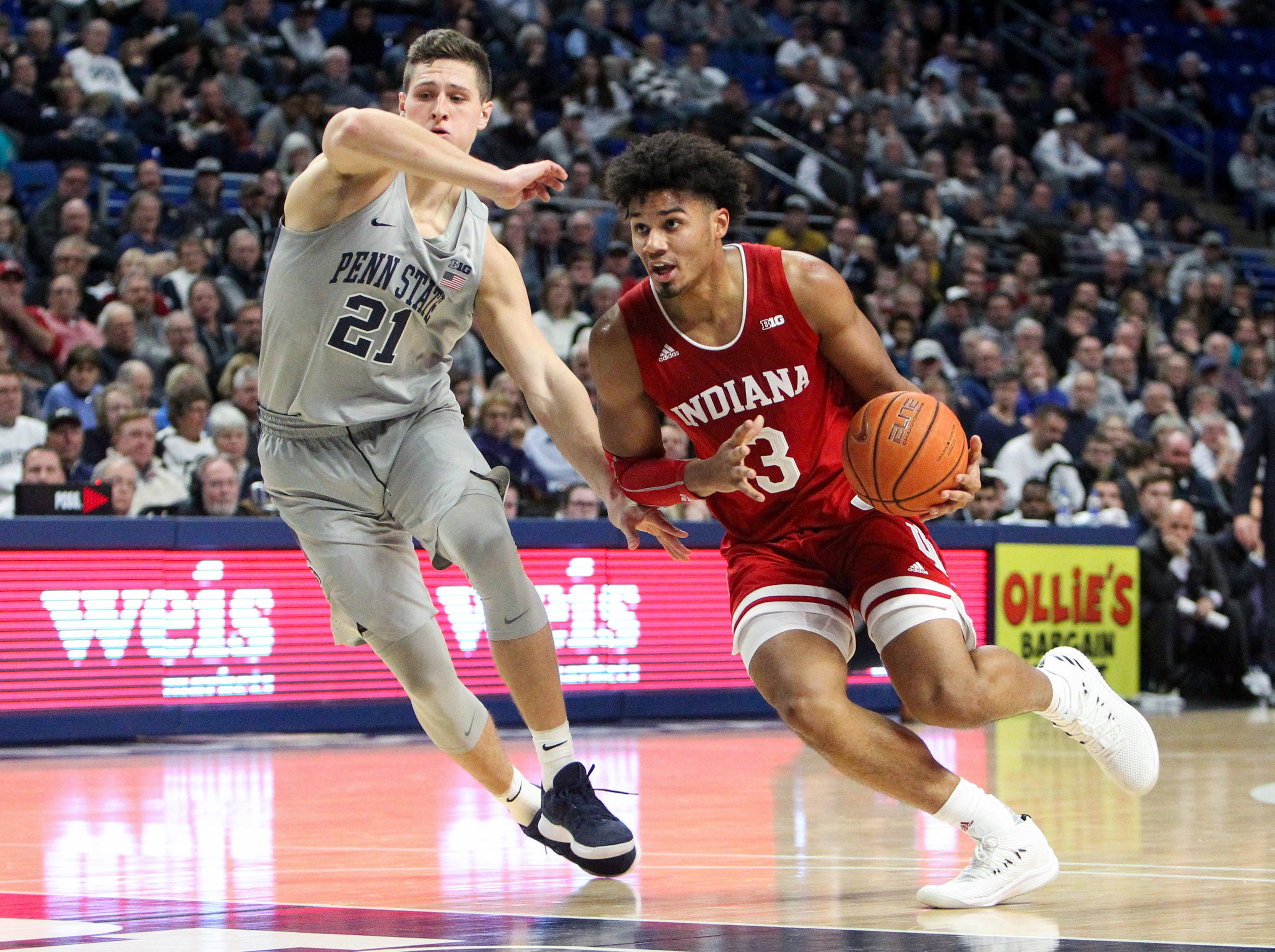 Dec 4, 2018; University Park, PA, USA; Indiana Hoosiers forward Justin Smith (3) dribbles the ball around the outside against Penn State Nittany Lions forward John Harrar (21) during the second half at Bryce Jordan Center. Indiana defeated Penn State 64-62. Mandatory Credit: Matthew O'Haren-USA TODAY Sports