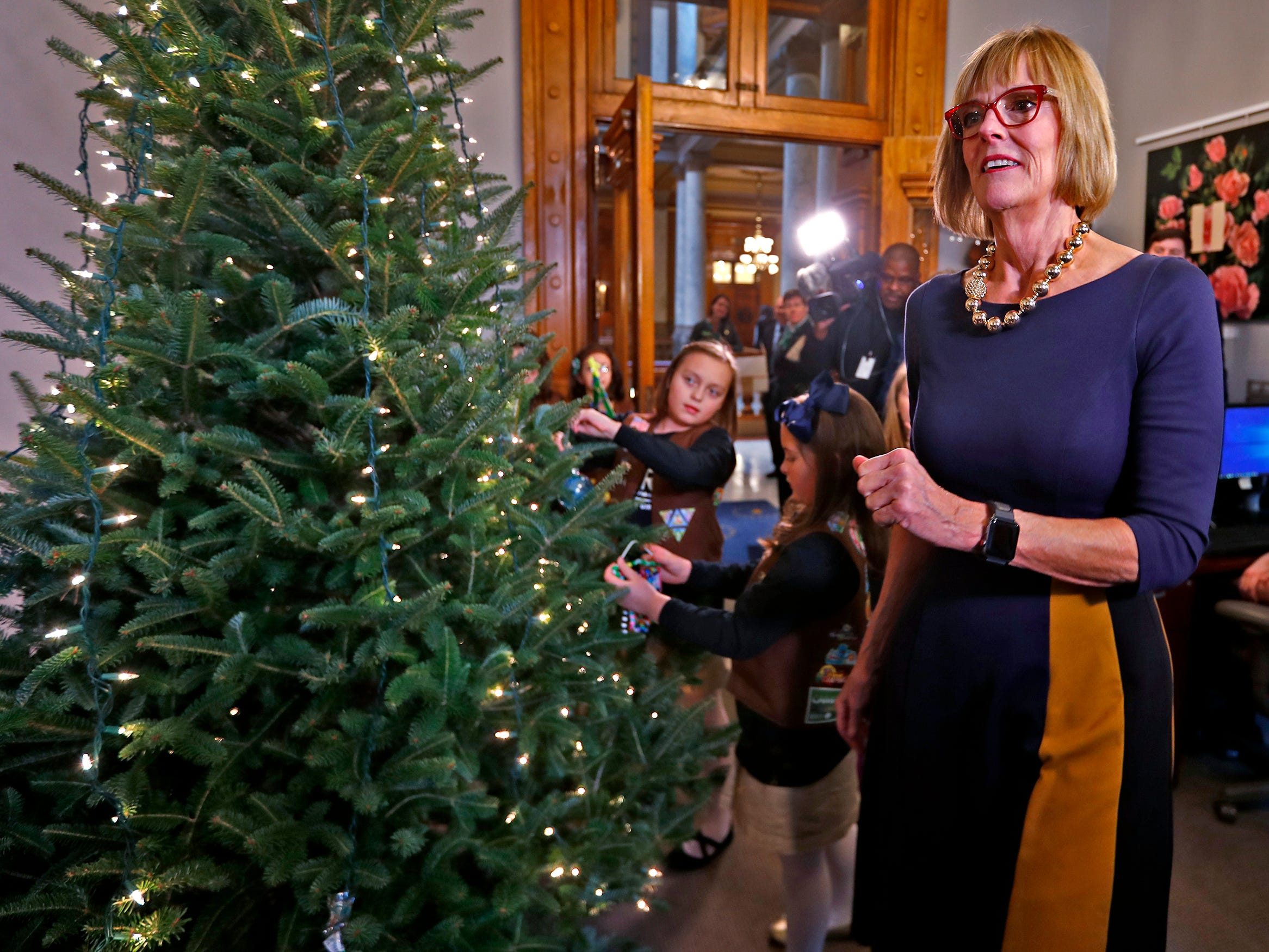 Lieutenant Governor Suzanne Crouch is joined by Brownies to decorate her Indiana Statehouse tree for the holidays, Wednesday, Dec. 5, 2018.  They used ornaments created by Girl Scouts from across Central Indiana for the tree.