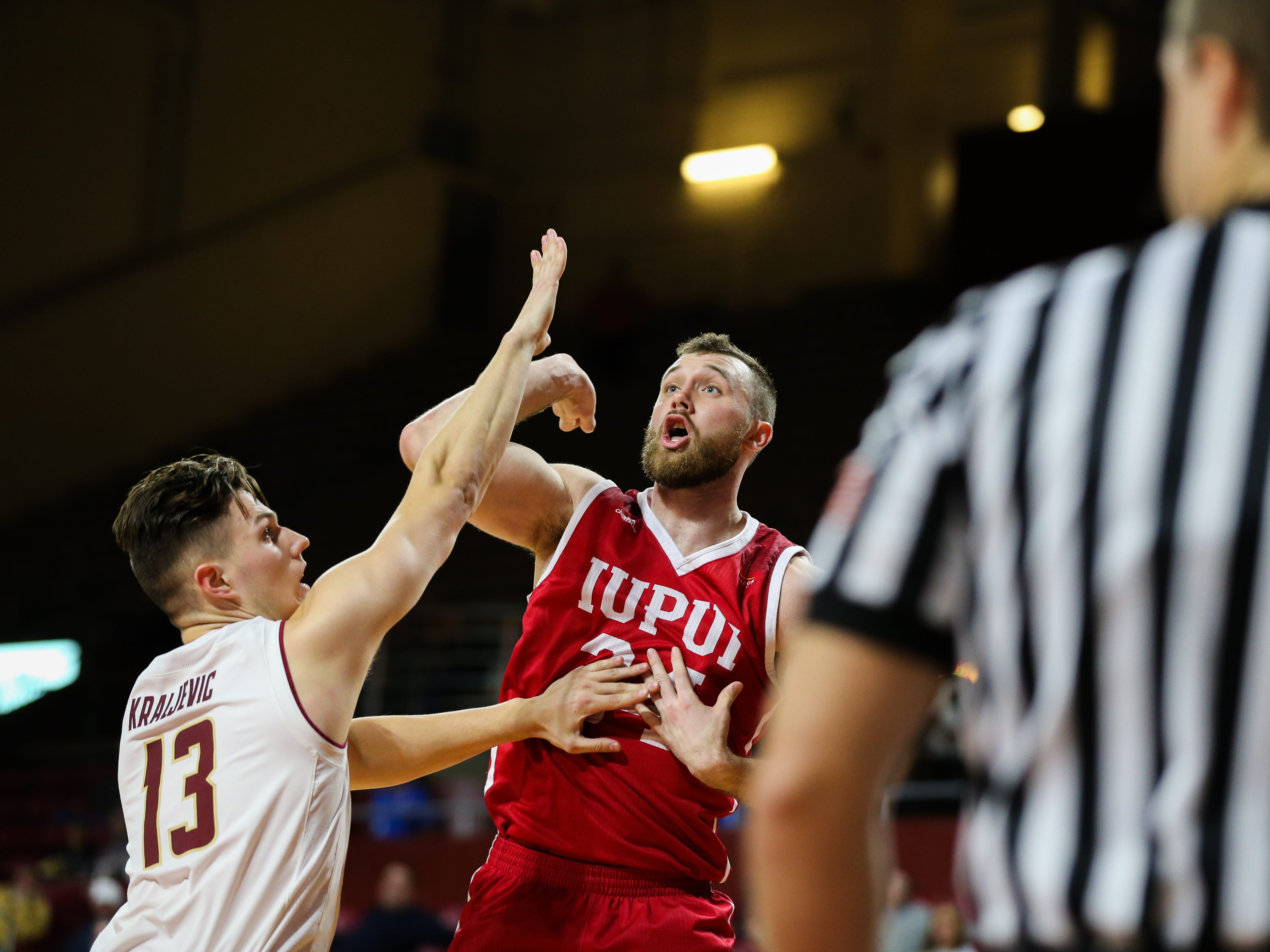 IUPUI forward Evan Hall lets go a jump shot against Boston College.