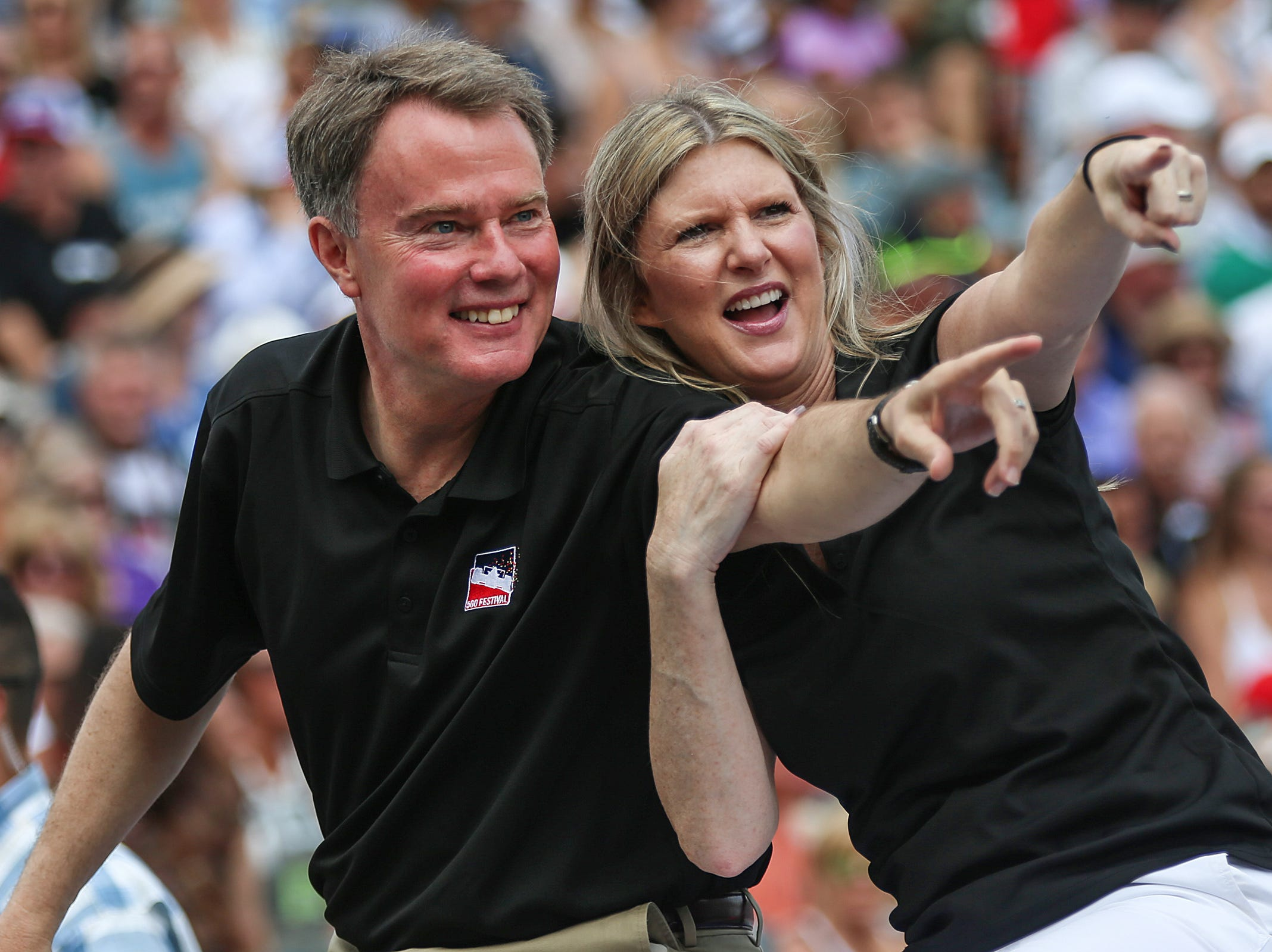 From left, Mayor Joe Hogsett and his wife Stephanie ride in the 500 Festival Parade in downtown Indianapolis, Saturday, May 26, 2018. The mid-day parade takes place a day before the Indy 500 mile race.