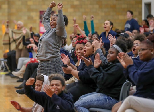 Fans cheer after Riverside Argonauts' Cadyn Ellis (3) makes a three point basket against the Lighthouse South Bulldogs at Riverside High School in Indianapolis on Tuesday, Dec. 4, 2018.