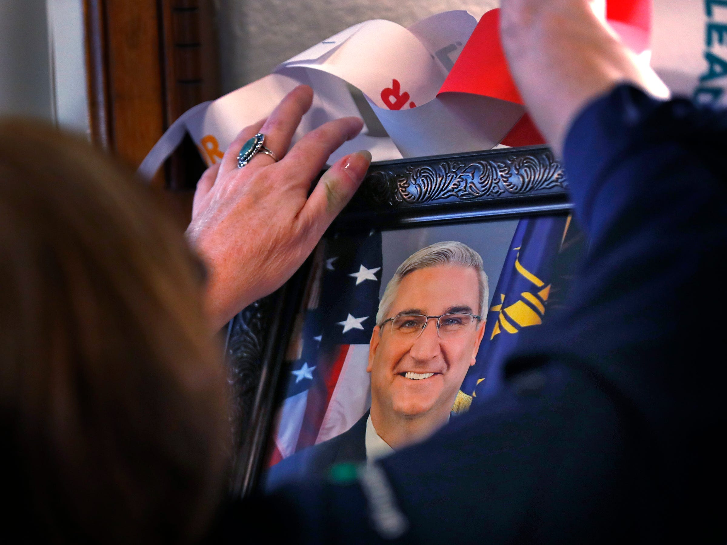 The mantle, including a portrait of Governor Eric Holcomb, is decorated as Girl Scouts join Lieutenant Governor Suzanne Crouch to decorate her Indiana Statehouse tree for the holidays, Wednesday, Dec. 5, 2018.  They used ornaments created by Girl Scouts from across Central Indiana for the tree.