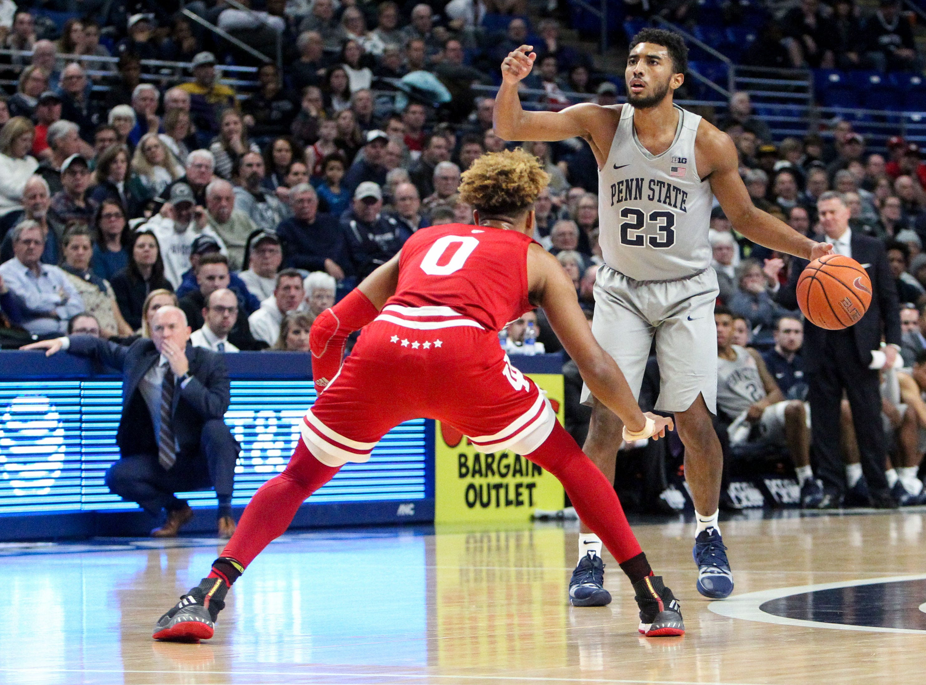 Dec 4, 2018; University Park, PA, USA; Penn State Nittany Lions guard Josh Reaves (23) signals as Indiana Hoosiers guard Romeo Langford (0) defends during the first half at Bryce Jordan Center. Indiana defeated Penn State 64-62. Mandatory Credit: Matthew O'Haren-USA TODAY Sports