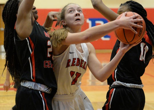 Roncalli's Alana Vinson (11) works to the hoop against North Central's defenders in the second half of the Marion County tournament at Roncalli High School in Indianapolis, Ind., Tuesday, Dec. 04, 2018. North Central defeated Roncalli 68-50 to advance and play Ben Davis on Thursday.