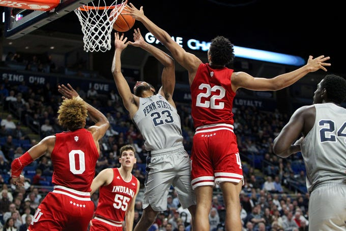 Dec 4, 2018; University Park, PA, USA; Indiana Hoosiers forward Clifton Moore (22) blocks a shot attempted by Penn State Nittany Lions guard Josh Reaves (23) during the first half at Bryce Jordan Center. Mandatory Credit: Matthew O'Haren-USA TODAY Sports