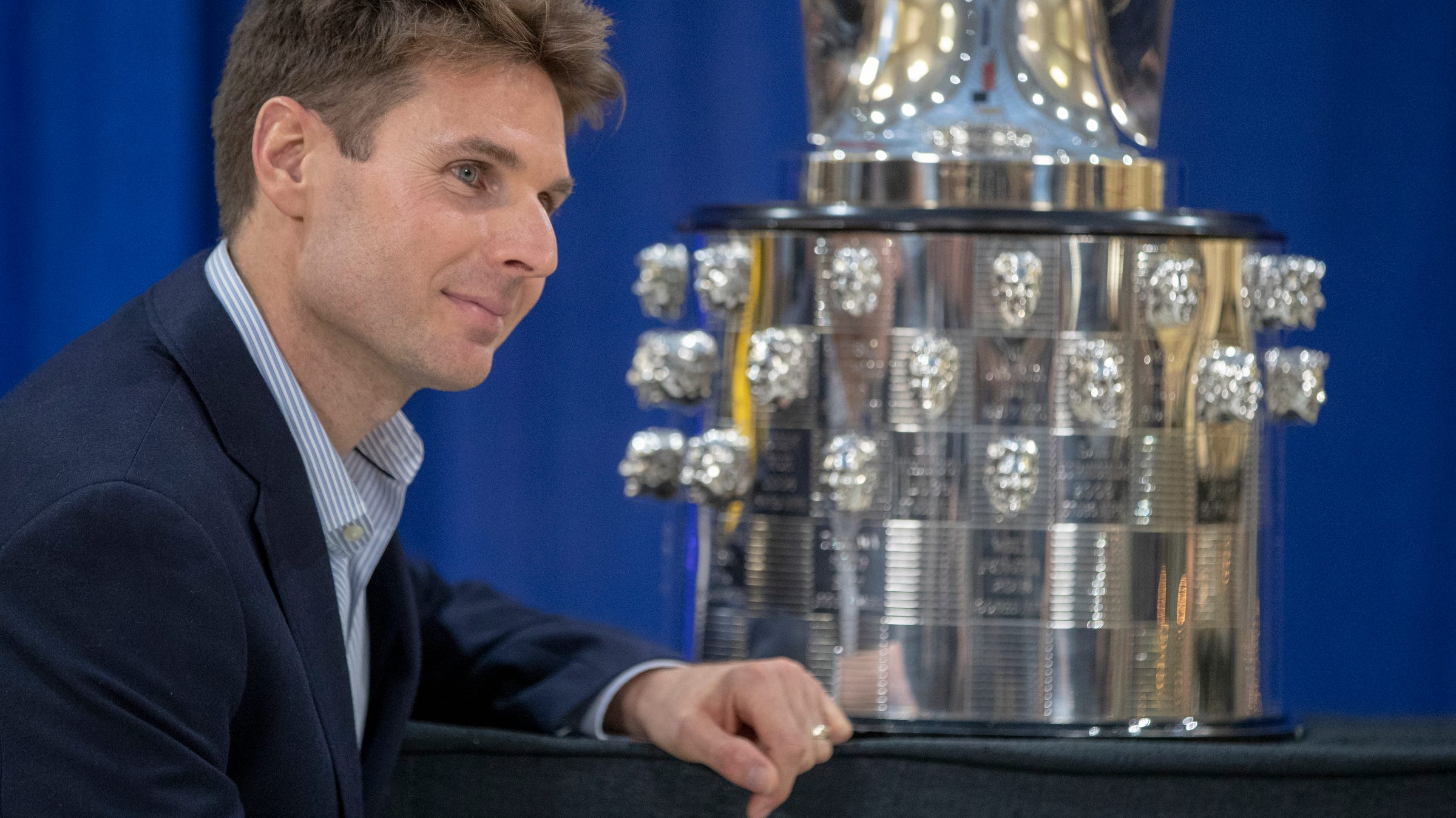 Will Power poses for photographers' cameras after his likeness was unveiled on the Borg-Warner trophy, Indianapolis Motor Speedway, Wednesday, Dec. 5, 2018. Power is an Australian driver with Team Penske, and is the 105th face on the trophy.