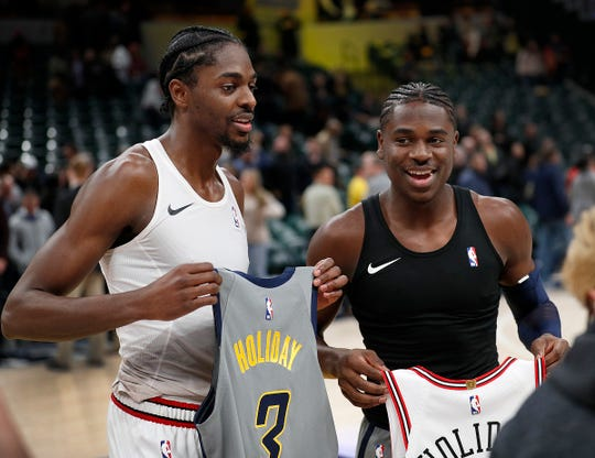 Indiana Pacers guard Aaron Holiday (3) and his brother Chicago Bulls forward Justin Holiday (7) exchange jerseys following their game at Bankers Life Fieldhouse on Tuesday, Dec. 4, 2018. The Indiana Pacers defeated the Chicago Bulls 96-90.