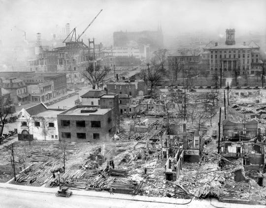 The demolition of buildings on the east side of Meridian Street looking north from Michigan Street made way for Veteran's Memorial Plaza, under construction in Downtown Indianapolis on Feb. 11, 1927. Also under construction was the Scottish Rite Cathedral.