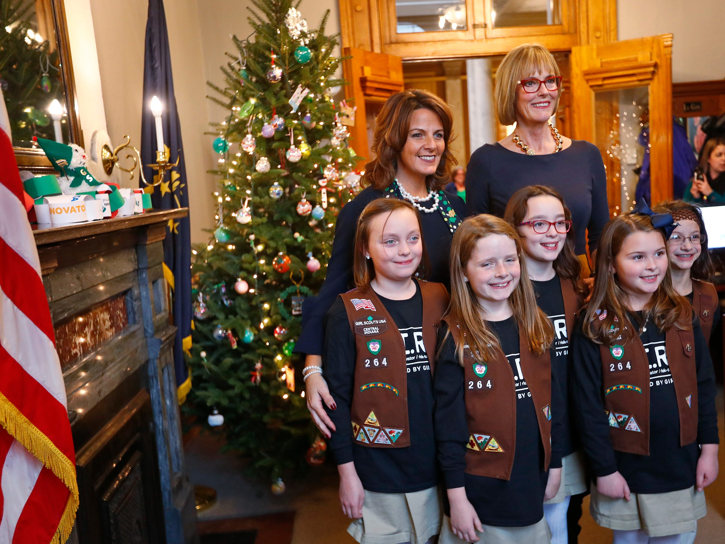 Girl Scouts of Central Indiana CEO Danielle Shockey and Lieutenant Governor Suzanne Crouch stand behind Brownies, from left, Colette Pardo, Vivian Bruno, Josie Pardo, Katie Callahan, and Ivy Lara, after they decorated Crouch's Statehouse tree for the holidays, Wednesday, Dec. 5, 2018.  They used ornaments created by Girl Scouts from across Central Indiana for the tree.