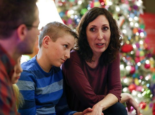 Kristi Schofield, right, with her son Elijah, 11, talks about her family's experience and stay at the Ronald McDonald House on Tuesday, Nov. 27, 2018.