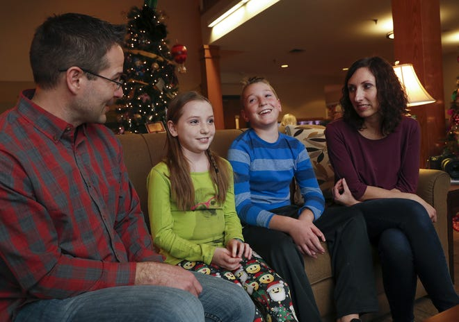 John and Kristi Schofield and their children Elijah, 11, and Brylee, 9, talk about their stay at the Ronald McDonald House on Nov. 27.