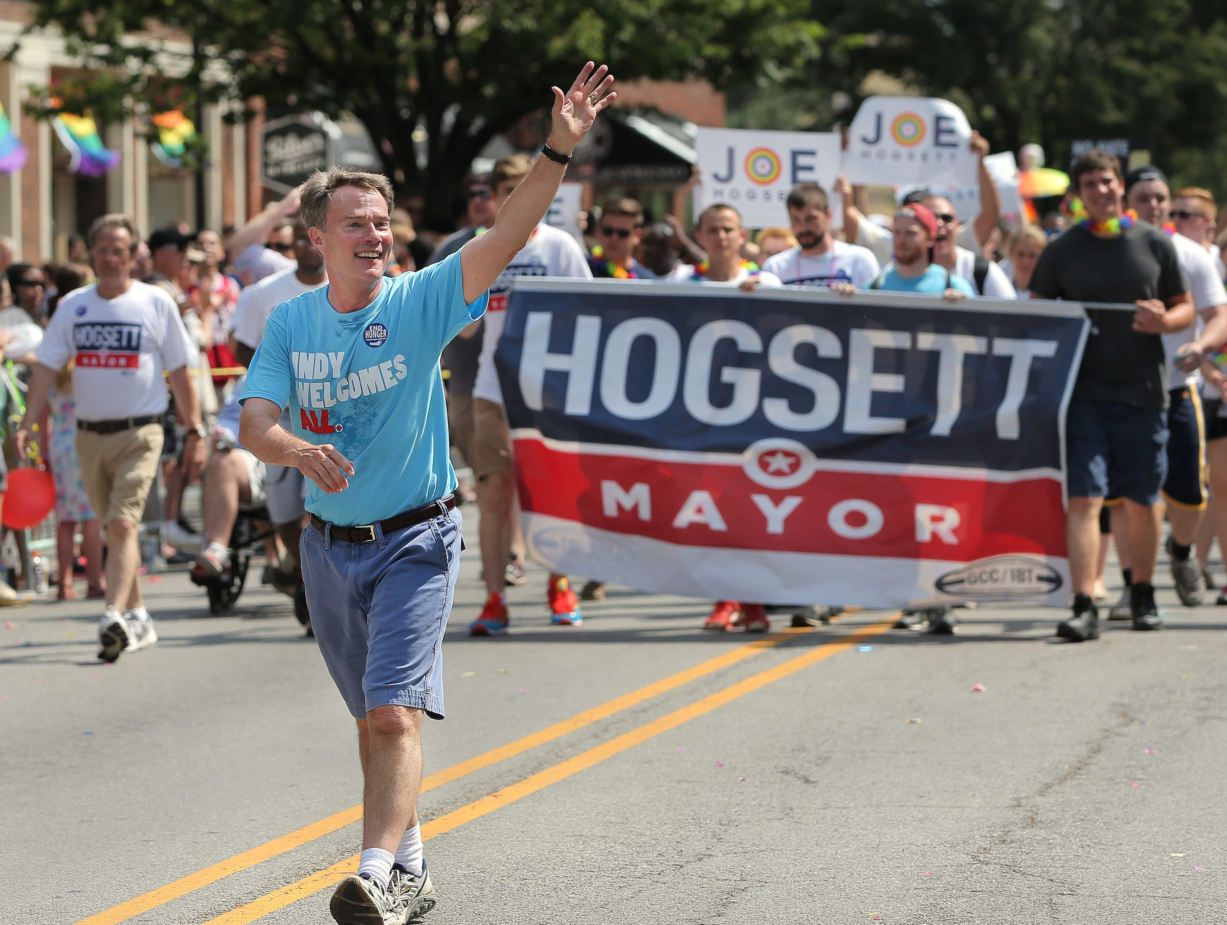 Mayoral candidate Joe Hogsett waves to the crowd during the Cadillac Barbie IN Pride Parade in downtown Indianapolis on Saturday, June 13, 2015.