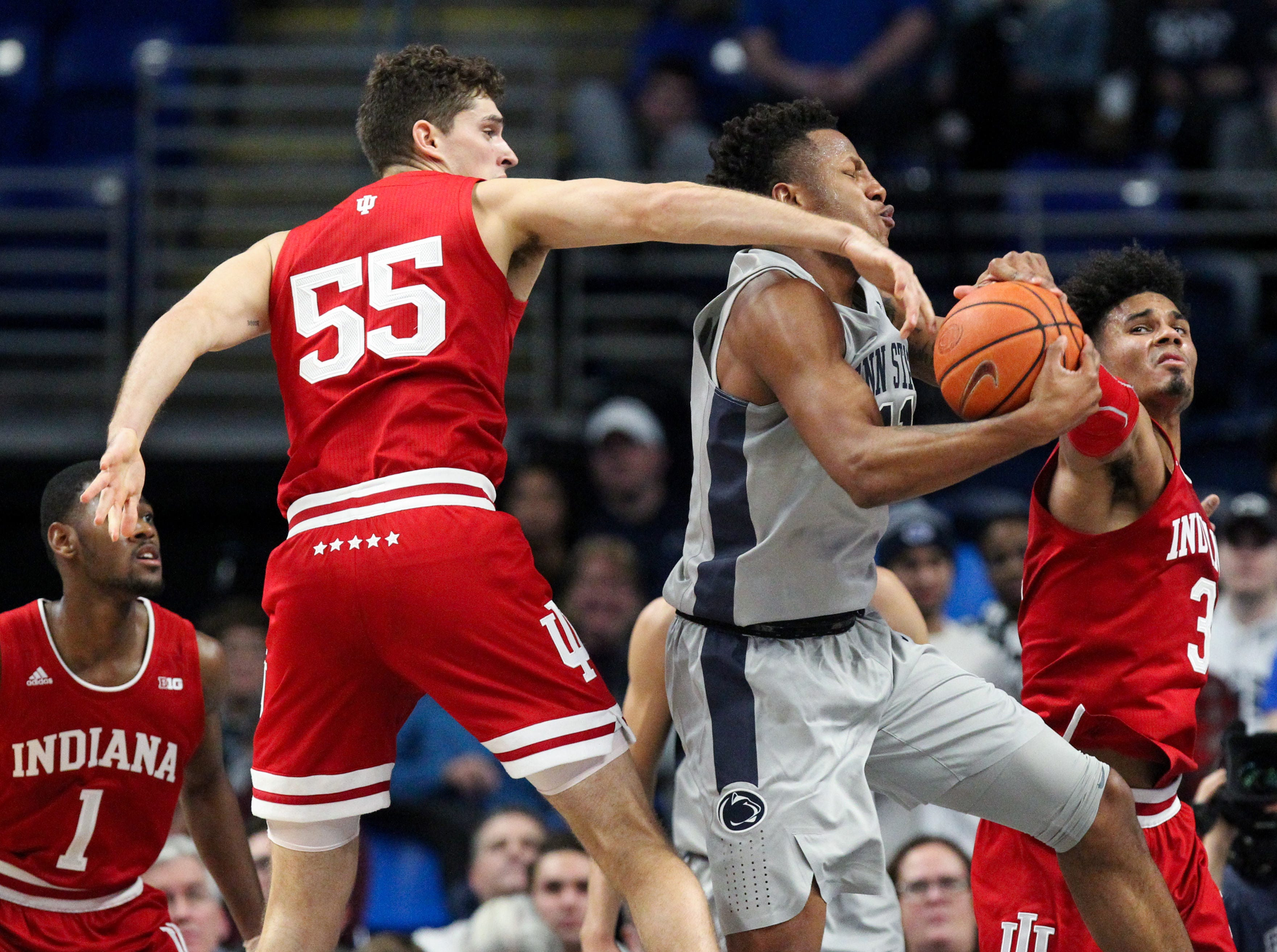 Dec 4, 2018; University Park, PA, USA; Penn State Nittany Lions forward Lamar Stevens (11) drives to the basket against Indiana Hoosiers forward Evan Fitzner (55) and forward Justin Smith (3) during the second half at Bryce Jordan Center. Indiana defeated Penn State 64-62. Mandatory Credit: Matthew O'Haren-USA TODAY Sports