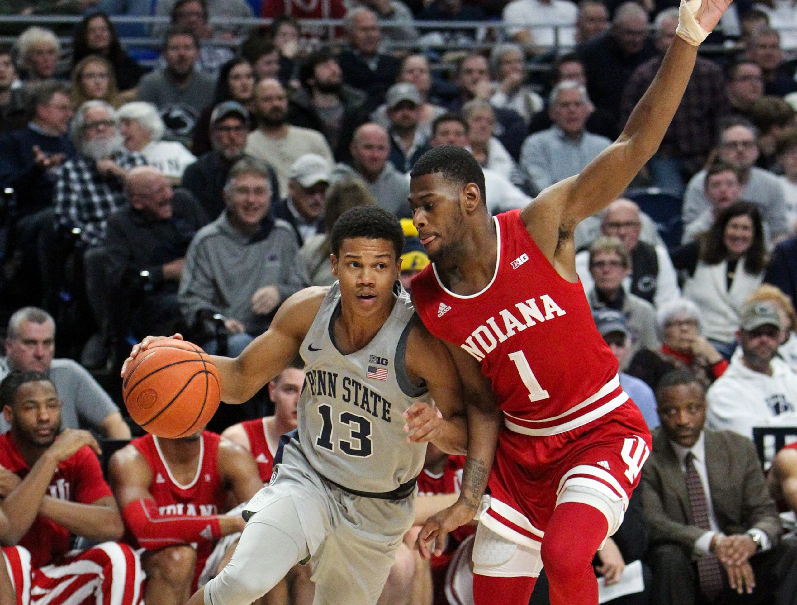 Dec 4, 2018; University Park, PA, USA; Penn State Nittany Lions guard Rasir Bolton (13) dribbles the ball against Indiana Hoosiers guard Aljami Durham (1) during the first half at Bryce Jordan Center. Indiana defeated Penn State 64-62. Mandatory Credit: Matthew O'Haren-USA TODAY Sports