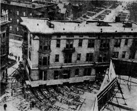 The three-story Cambridge apartment house is rotated to be moved from Pennsylvania and Michigan to its new home at Delaware and North streets in 1926.