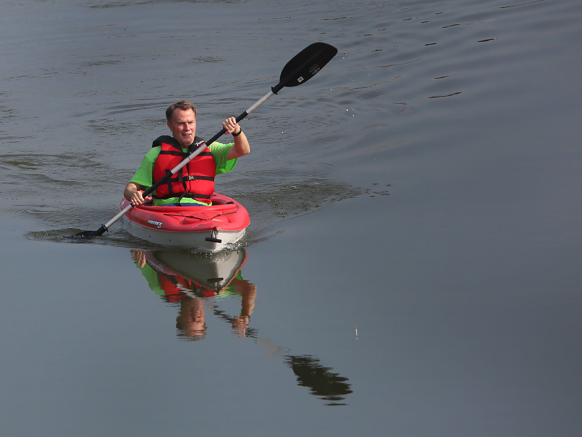 Mayor Joe Hogsett canoes on the White River to downtown on Canoe to Work Day, Friday, June 1, 2018.  He and others canoed and kayaked down the Indianapolis waterways to downtown.  CBBEL (Christopher B. Burke Engineering, LLC) and Citizens Energy Group sponsored the event to celebrate the Indiana waterways, and the mayor officially proclaimed June 1 as Canoe to Work Day in Indianapolis.