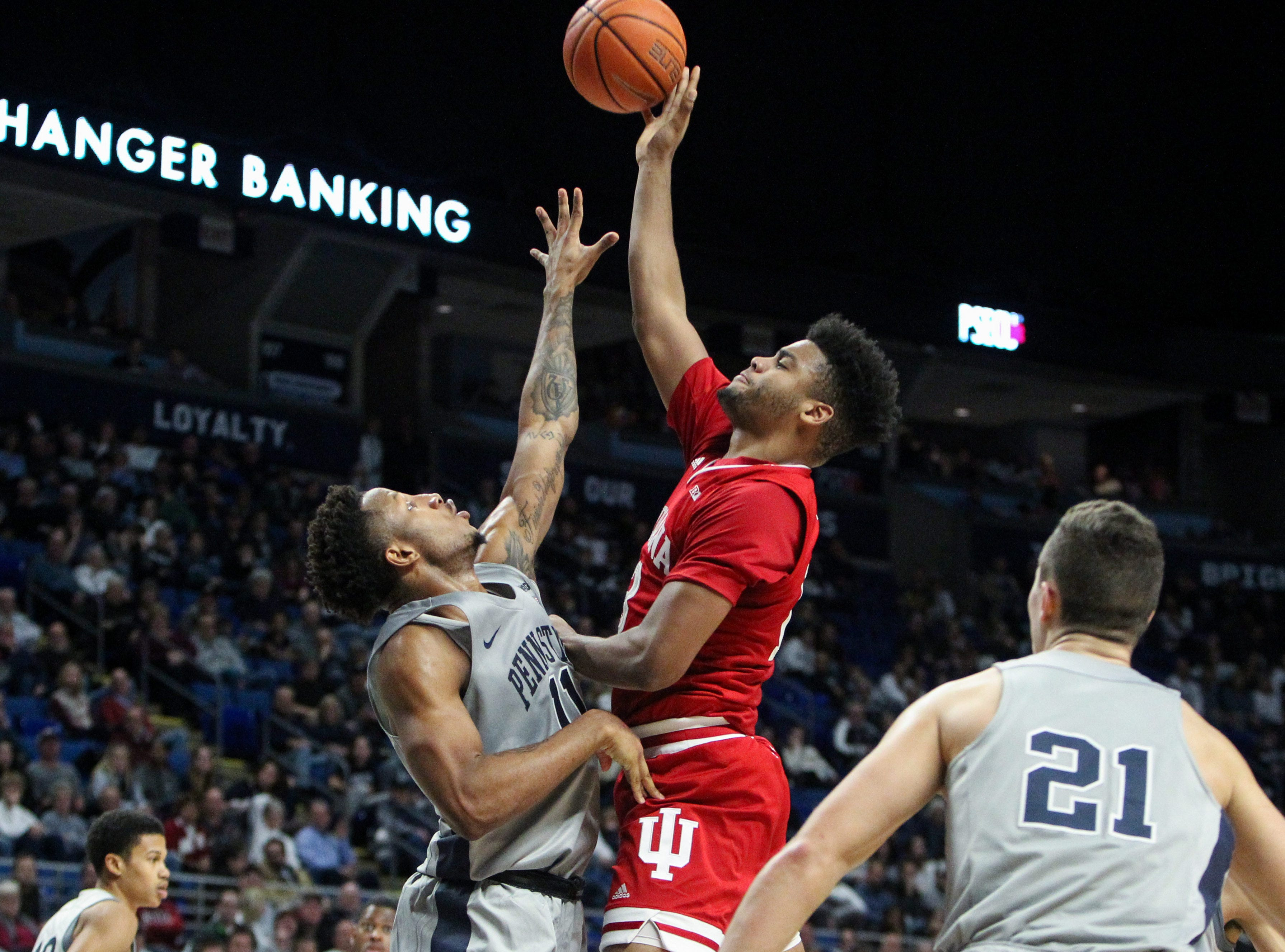 Dec 4, 2018; University Park, PA, USA; Indiana Hoosiers forward Juwan Morgan (13) drives to the basket against Penn State Nittany Lions forward Lamar Stevens (11) during the second half at Bryce Jordan Center. Indiana defeated Penn State 64-62. Mandatory Credit: Matthew O'Haren-USA TODAY Sports