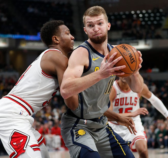 Indiana Pacers forward Domantas Sabonis (11) spins on Chicago Bulls forward Wendell Carter Jr. (34) in the second half of their game at Bankers Life Fieldhouse on Tuesday, Dec. 4, 2018. The Indiana Pacers defeated the Chicago Bulls 96-90.