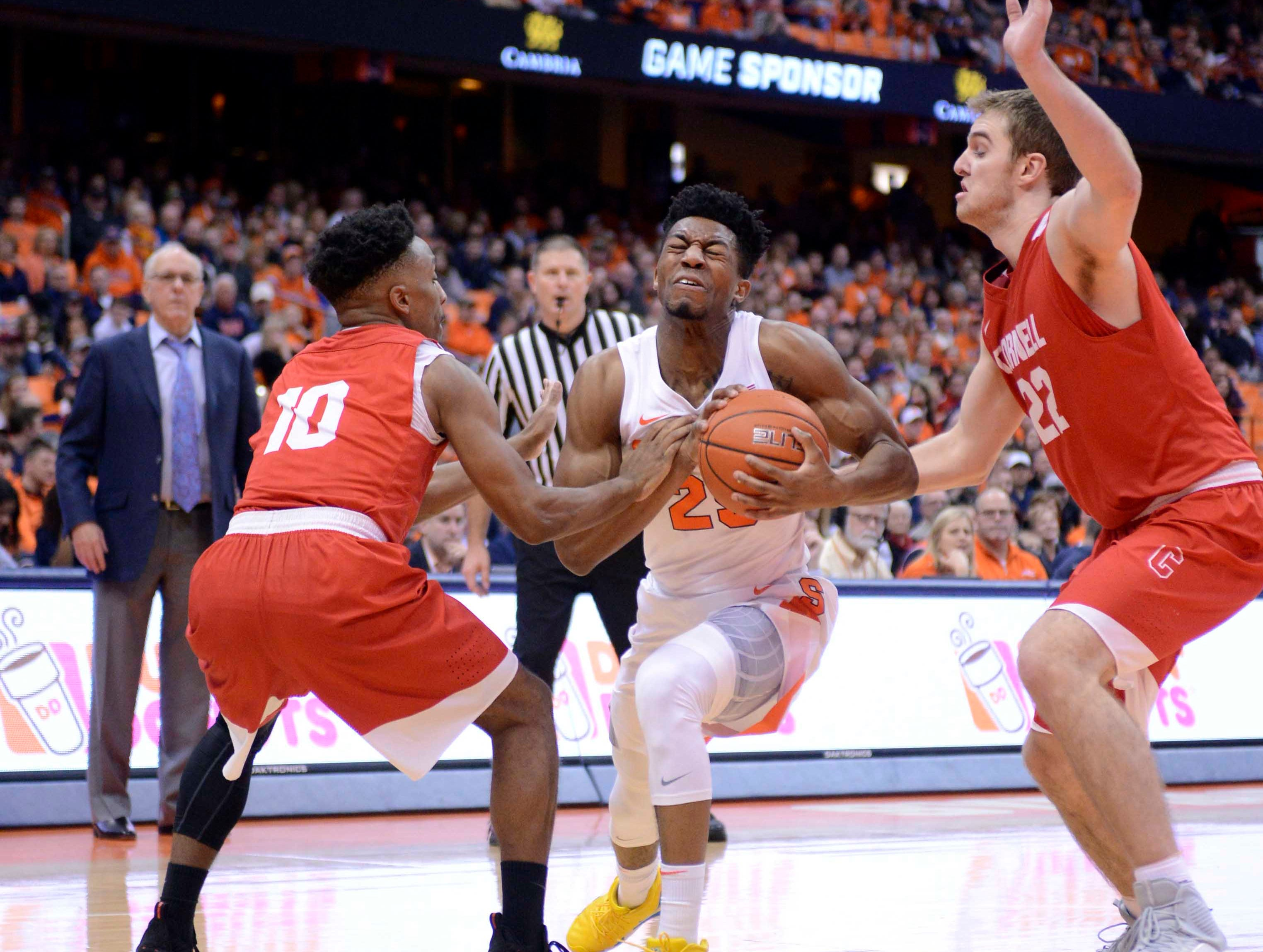 Dec 1, 2018; Syracuse, NY, USA; Syracuse Orange guard Tyus Battle (25) is pressured between Cornell Big Red guard Matt Morgan (10) and forward Josh Warren (22) during the second half at the Carrier Dome. Mandatory Credit: Mark Konezny-USA TODAY Sports