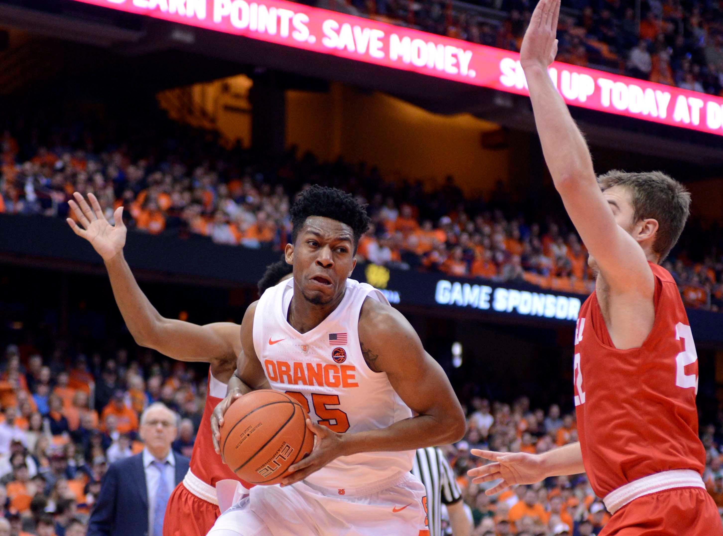 Dec 1, 2018; Syracuse, NY, USA; Syracuse Orange guard Tyus Battle (25) drives the ball as Cornell Big Red forward Josh Warren (22) defends during the second half at the Carrier Dome. Mandatory Credit: Mark Konezny-USA TODAY Sports