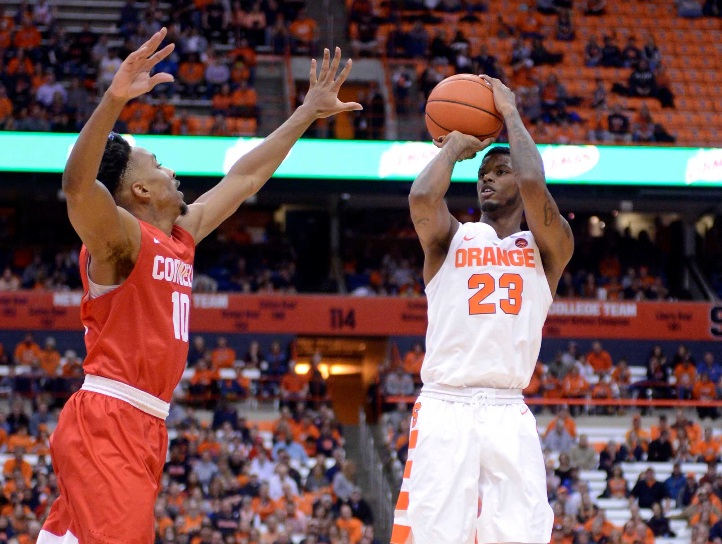 Dec 1, 2018; Syracuse, NY, USA; Syracuse Orange guard Frank Howard (23) takes a jump shot as Cornell Big Red guard Matt Morgan (10) defends during the second half at the Carrier Dome. Mandatory Credit: Mark Konezny-USA TODAY Sports