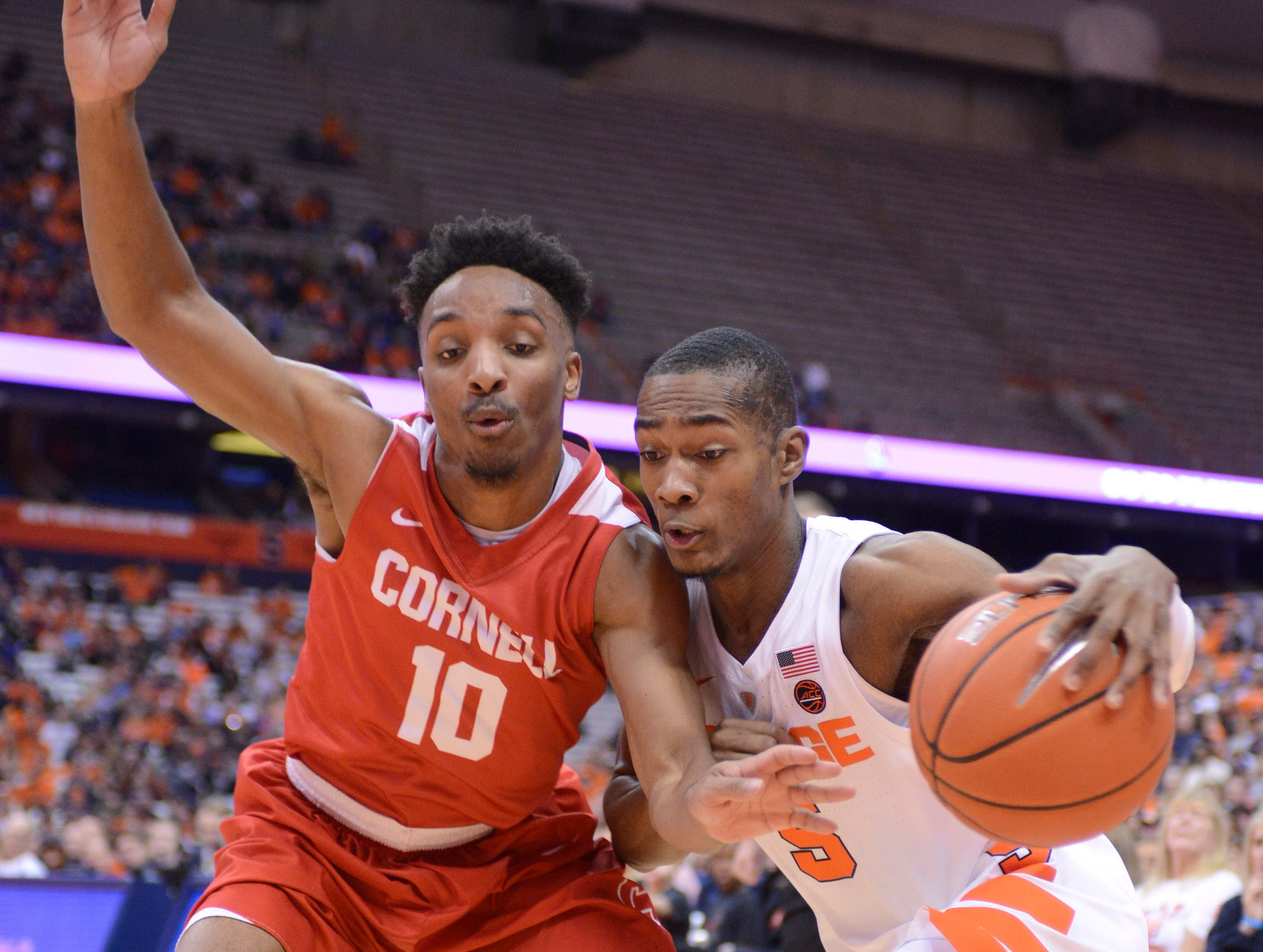 ]Dec 1, 2018; Syracuse, NY, USA; Syracuse Orange guard Jalen Carey (5) tries to drive the ball past Cornell Big Red guard Matt Morgan (10) during the second half at the Carrier Dome. Mandatory Credit: Mark Konezny-USA TODAY Sports