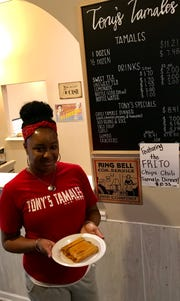 LaShara Mosley shows tamales, which are the mainstay of Tony's Tamales Too.