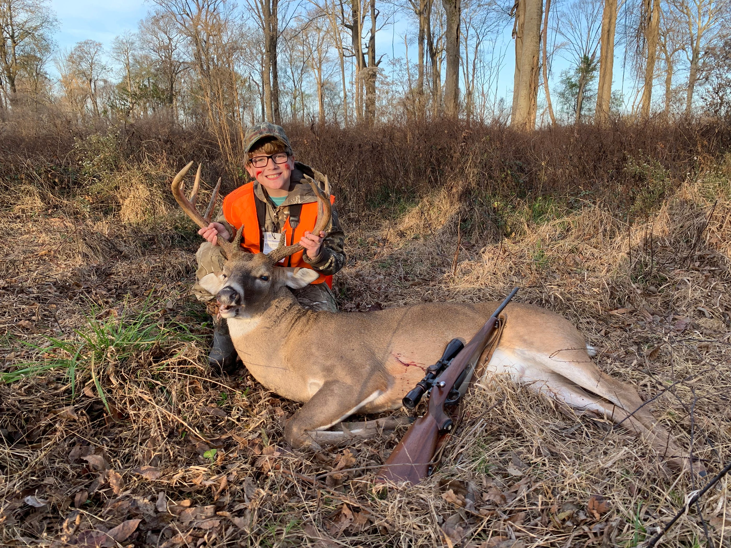 William Holladay, 10, of Madison, harvested this 9-point near Rosedale. A grunt call pulled the buck in for a perfect shot.