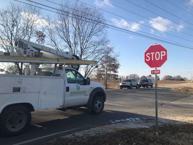 A 1Tennessee truck stops before turning right from Mt. Zion Road onto Middle School Road in Medina hours after the stop signs were installed on both directions of the road.