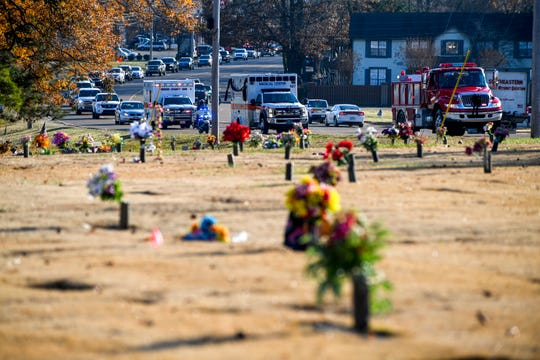 The ambulance carrying the body of Zach Pruitt, center, follows a fire engine and leads the rest of a funeral procession down North Highland towards the funeral at Highland Memorial Gardens in Jackson, Tenn., on Wednesday, Dec. 5, 2018.