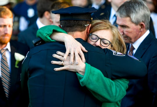 Deborah Wood embraces an attendee at the funeral for her son Zach Pruitt while the party awaits the burial of Pruitt at Highland Memorial Gardens in Jackson, Tenn., on Wednesday, Dec. 5, 2018.