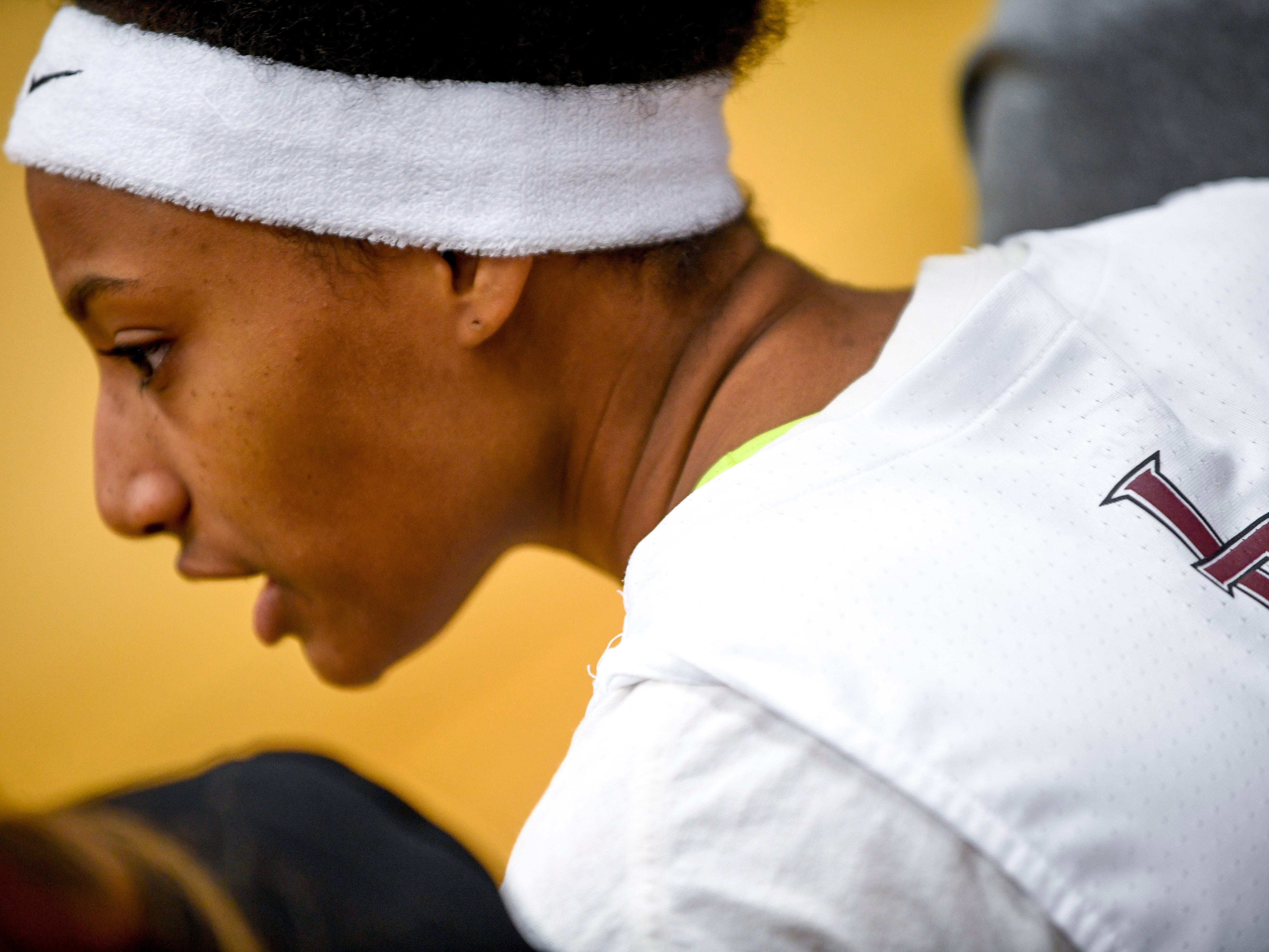Liberty players wore a white head band to honor their teammate Nyjah Jackson and her mother Nyema Jackson after Nyema was killed in an accident over the weekend at a TSSAA girls basketball game where Liberty played Ripley High School at Liberty Tech High School in Jackson, Tenn., on Tuesday, Dec. 4, 2018.