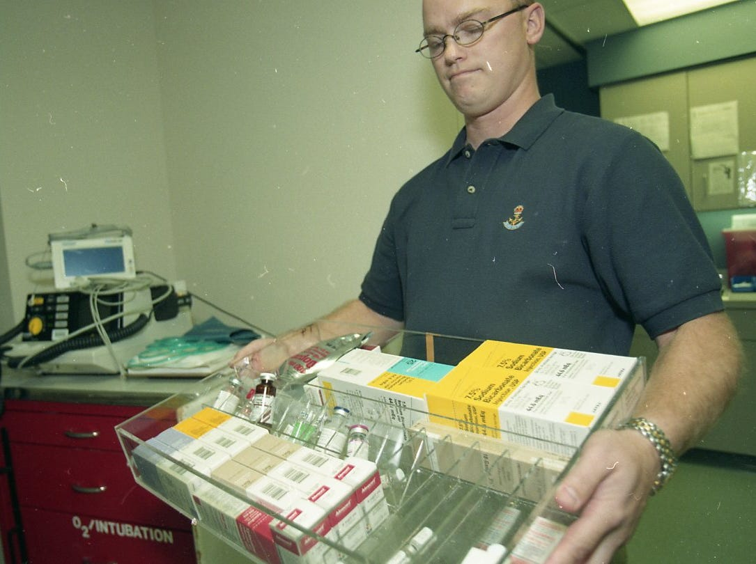 Lelan Stice, director of pharmacy at St. Mary's Medical Center, holds a tray full of drugs like the drugs that were stolen sometime during the night in September 1998. Hospital officials warn that improper and unsupervised use of these drugs in dangerous.
