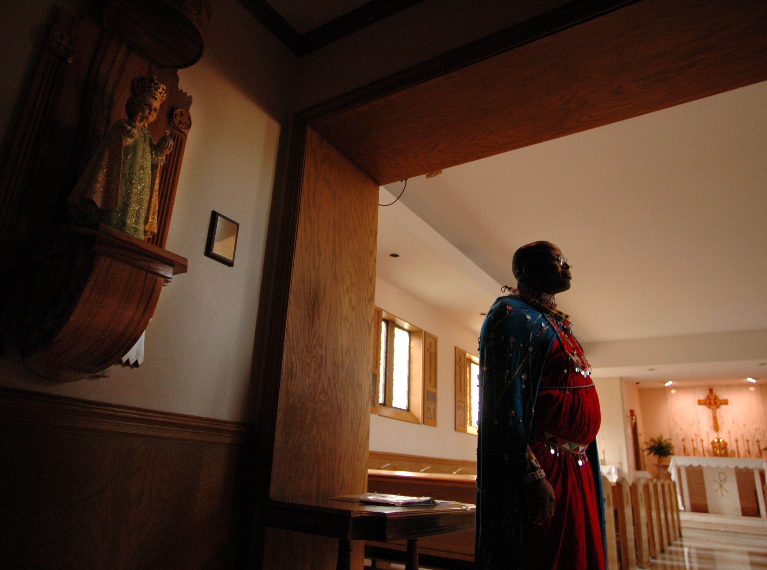 \Dressed in his traditional clothing, Josiah Muesha, a member of the Maasai community in Kenya, checks out the Chapel on his tour of St. Mary's Hospital in North Knoxville Tuesday afternoon. 10/18/2005