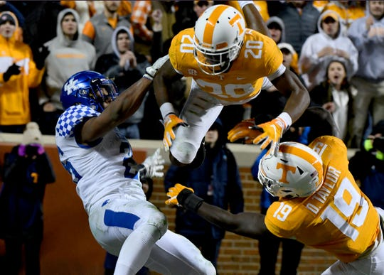 Tennessee defensive back Bryce Thompson (20) goes airborne to break up a pass intended Kentucky running back Benny Snell Jr. (26) during first half action in the Kentucky game Saturday, November 10, 2018 at Neyland Stadium in Knoxville, Tenn.
