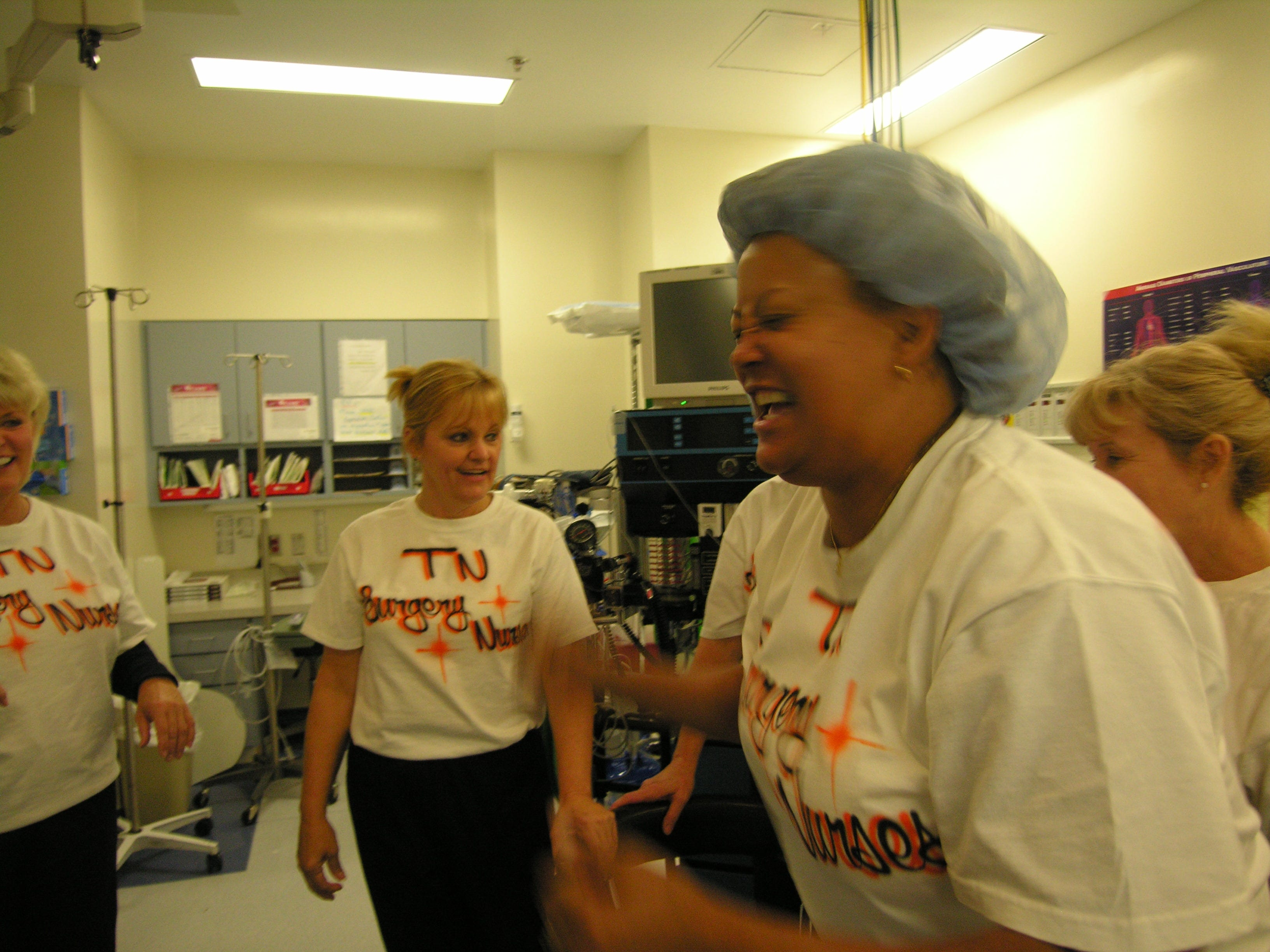 Talking about her experience as a contestant on the Price is Right television show gives St. MaryÕs charge nurse Charlene Minefield a chance to relive it, and here she gives an impromptu demonstration of the dance she did during auditions for the show. In background from left are nurses Melody Vineyard, Donna Turner and Geneva Wise.