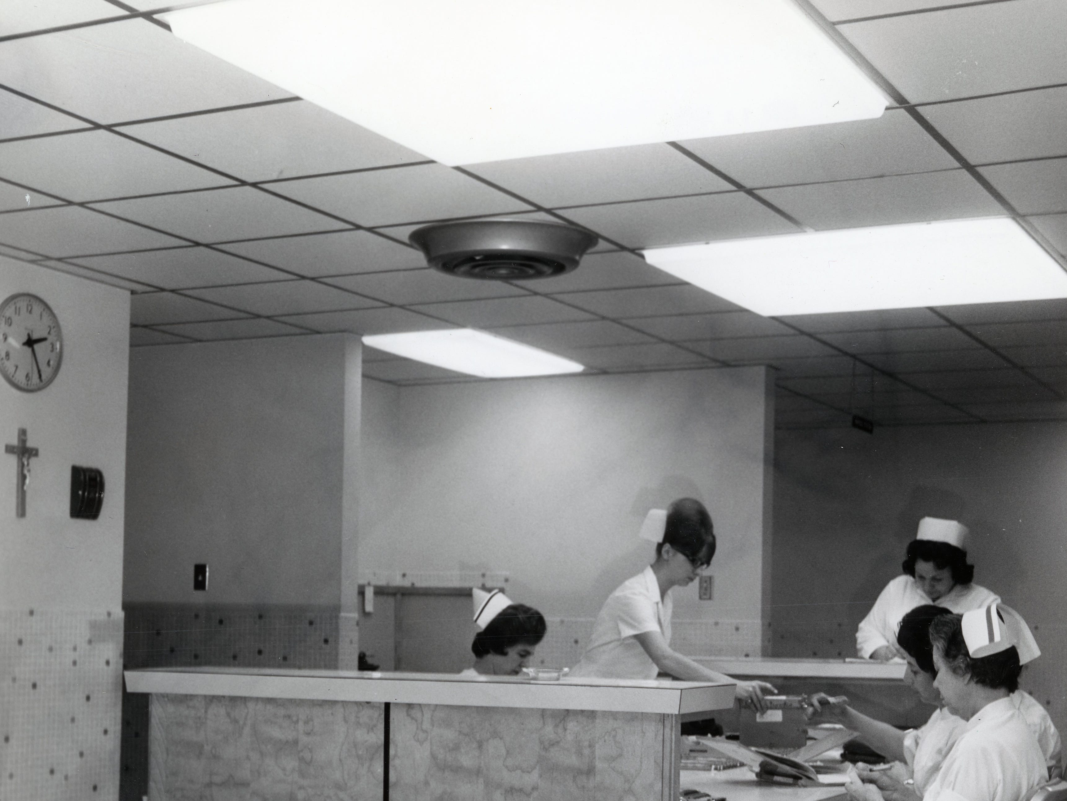 Nurses work at a nurses station on the patient floor in the new Annunciation Wing at St. Mary's Hospital in March 1966.