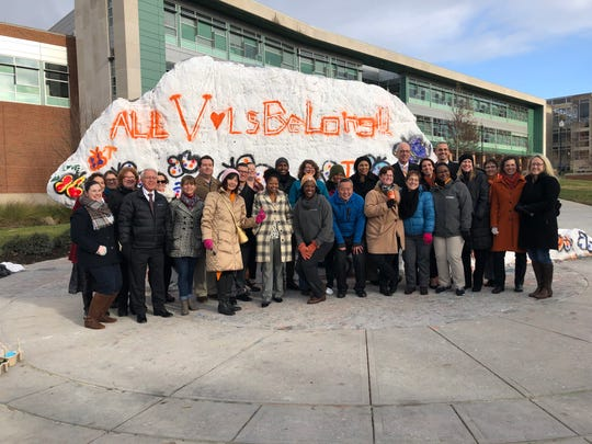 UT Knoxville faculty, staff and students stand in front of the Rock after painting a message of unity on Wednesday, Dec. 5, 2018.