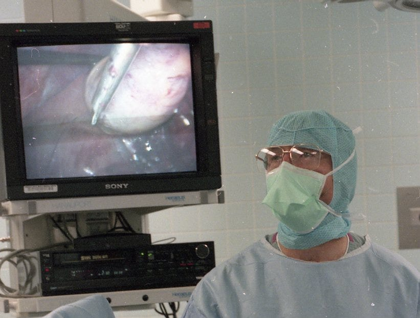 Dr. Robert Collier uses a harmonic scalpel, which uses ultrasonic waves, during a recent gallbladder surgery at St. Mary's Medical Center in 1996. On the screen behind the surgeon is the gallbladder as well as the harmonic scalpel.