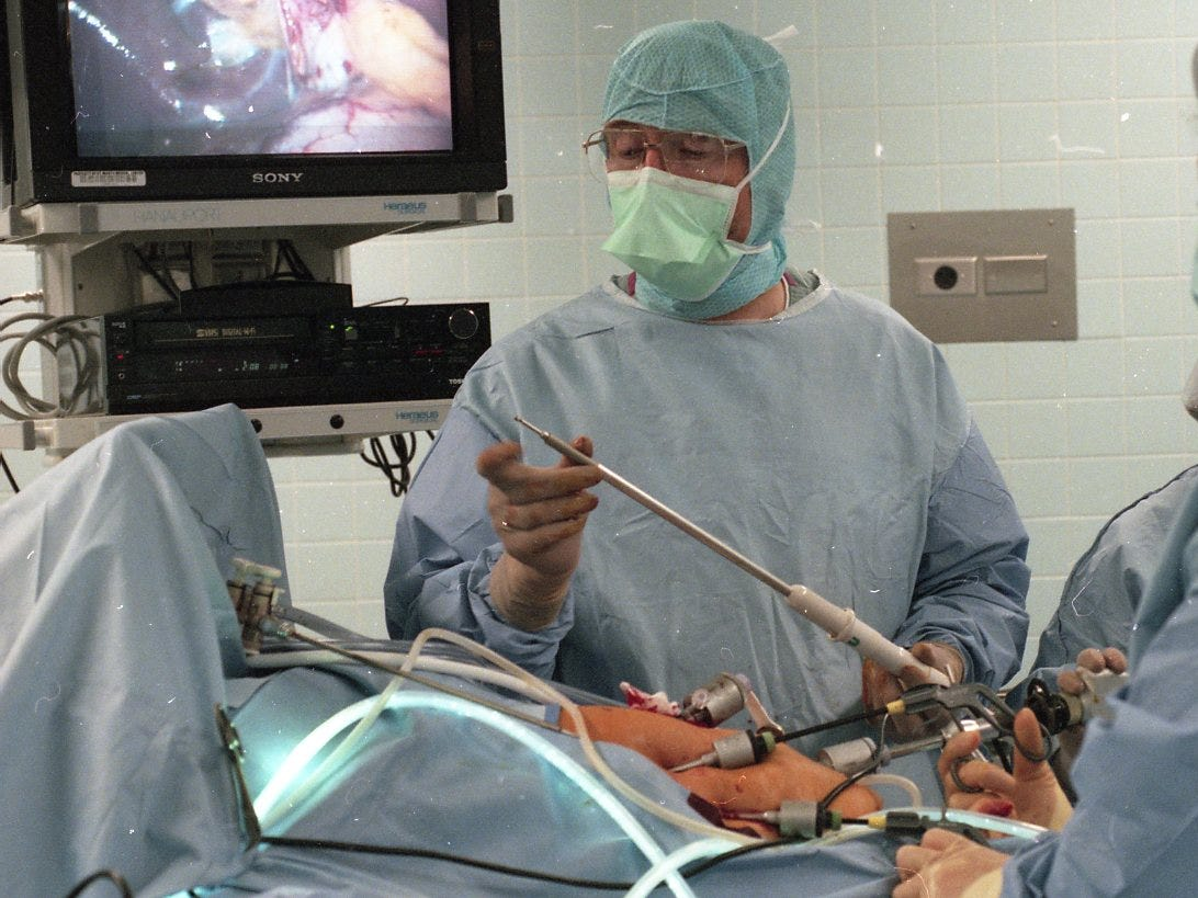 Dr. Robert Collier prepares to insert and use the harmonic scalpel during a recent gallbladder surgery at St. Mary's Medical Center in 1996.