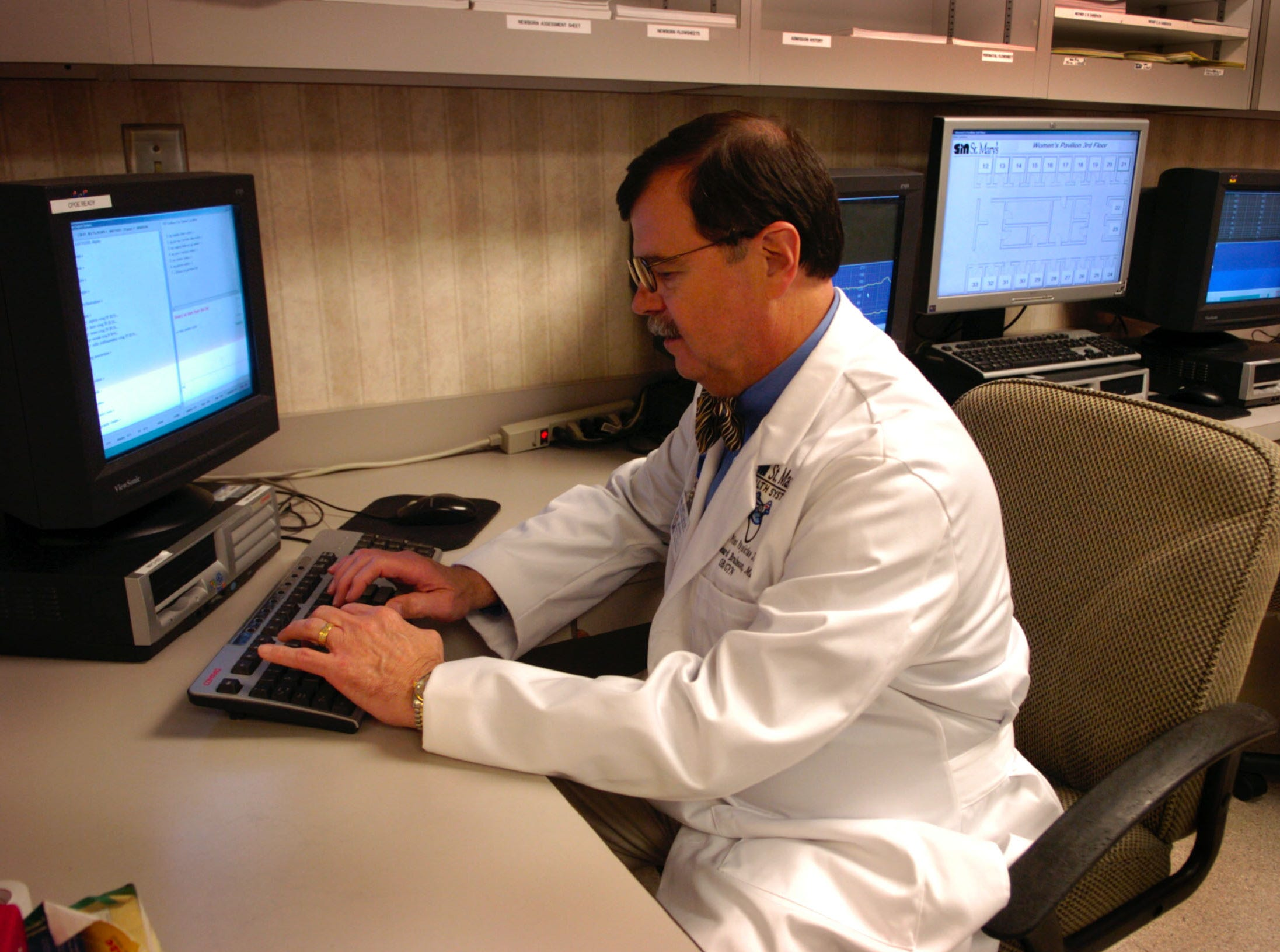 Leonard Brabson M.D.,  shows the computerized patient order entry system that has been implemented at St. Mary's Health System.  The system allows doctors to put medication orders directly into a computer instead of hand written noters.