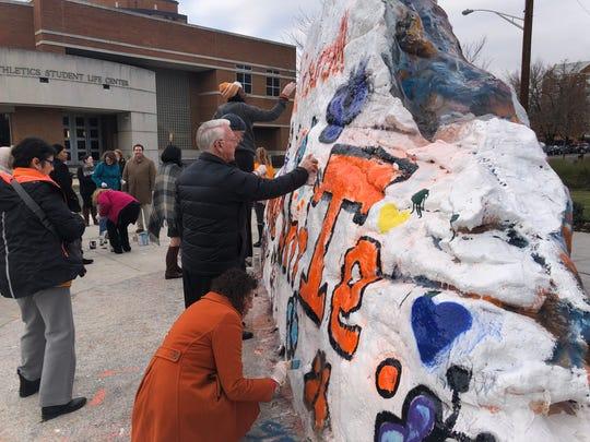 UT Knoxville Interim Chancellor Wayne Davis paints the Rock on Wednesday. Dec. 5, 2018.