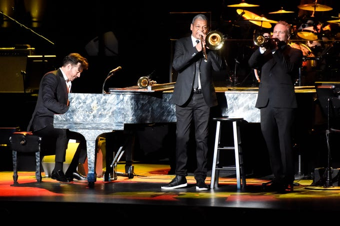 Harry Connick Jr. plays piano alongside his band mates at the Tennessee Theatre in Knoxville on Dec. 4, 2018. Connick was in town for the holiday edition of his New Orleans Tricentennial Celebration.