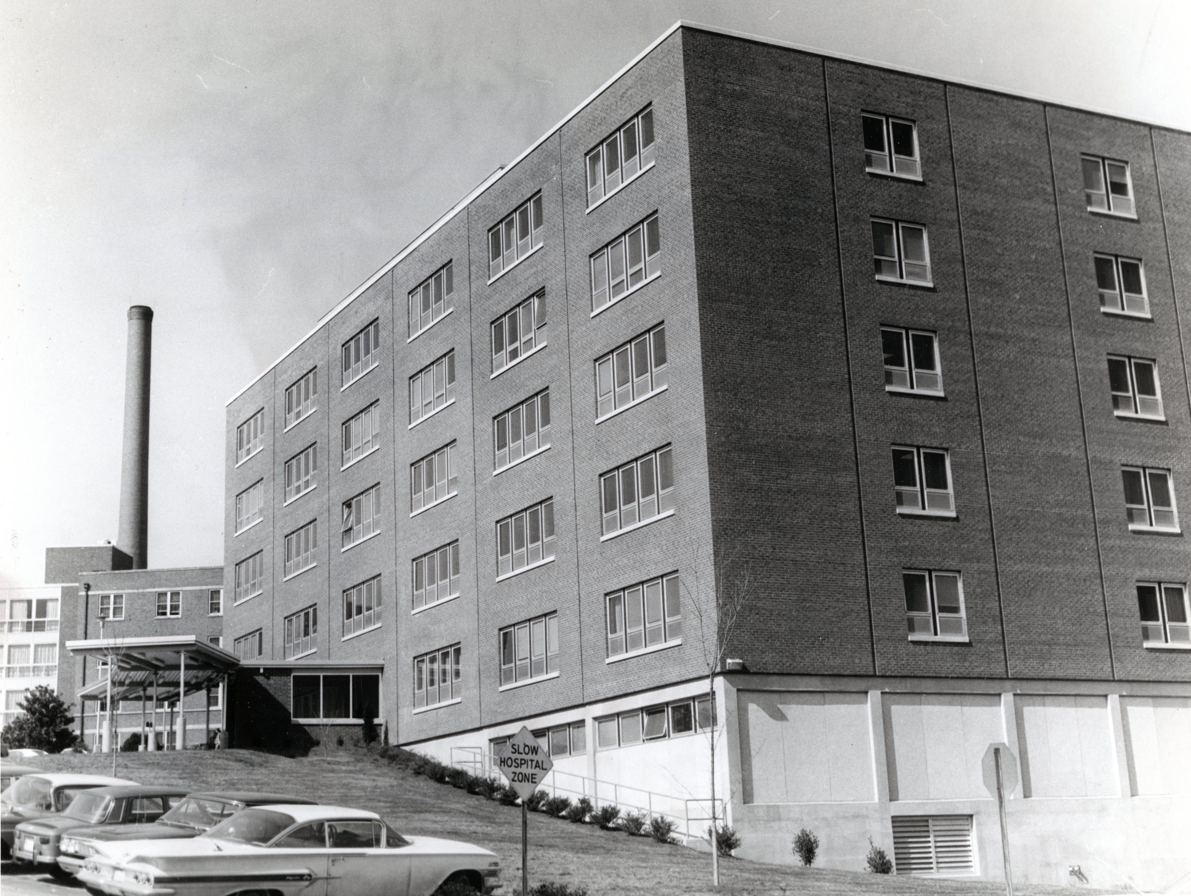 Outside view of the new seven-story (two below the ground) Annunciation Wing at St. Mary's Hospital. The new wing curves broadly toward the nurses home from the Marion Wing. Outside, it conforms with the general St. Mary's look in design and materials.