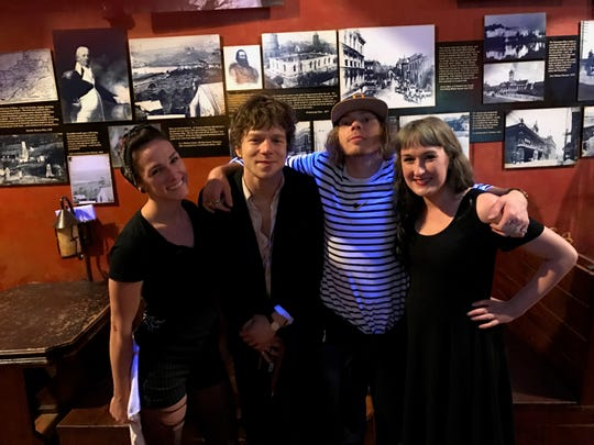 Standing between two fans, Cage the Elephant members Matt Shultz (left) and Jared Champion pose for a photo at Preservation Pub in Knoxville following their performance at Bijou Theatre on April 27, 2018.