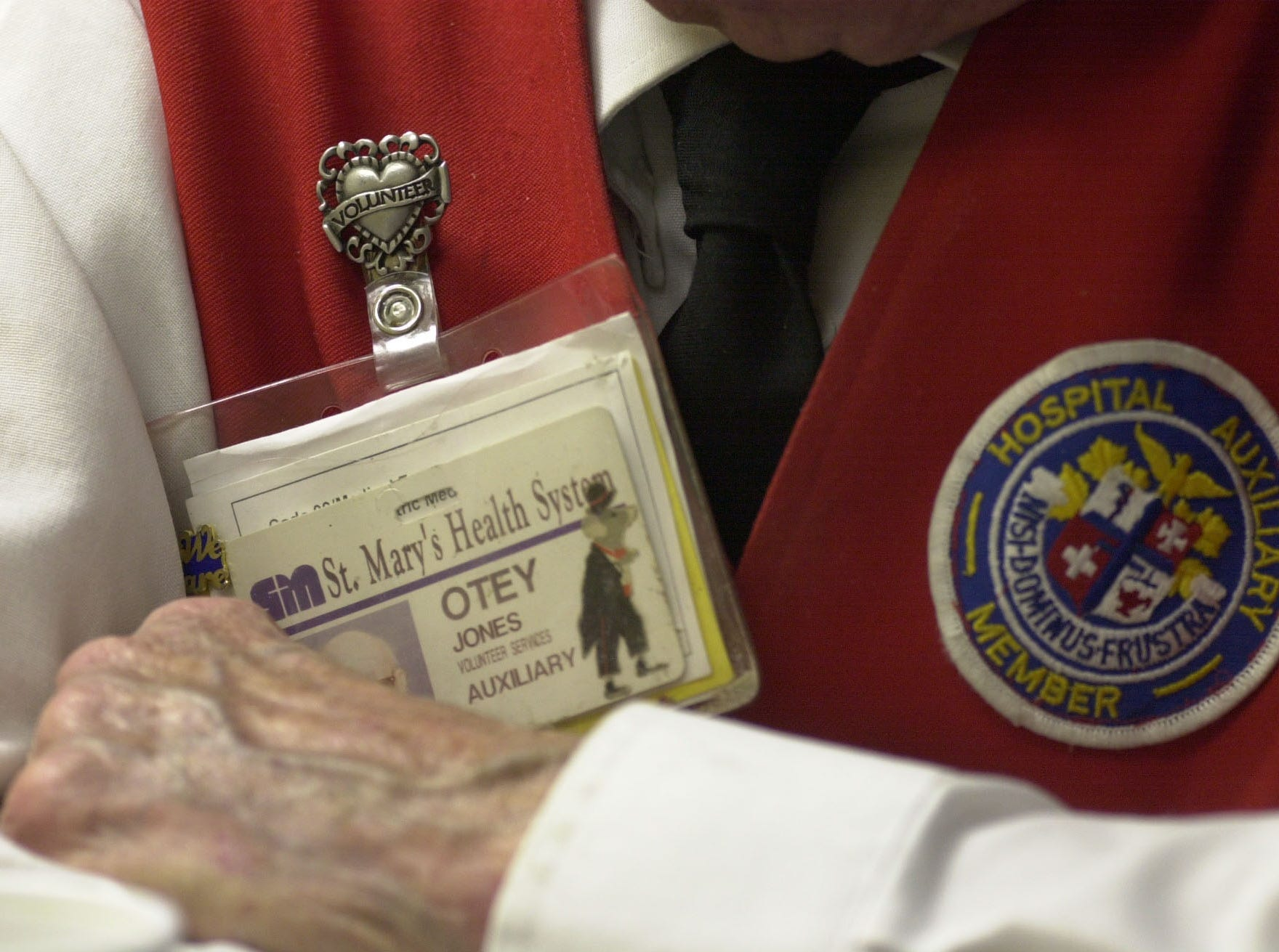Detail shot of Otey Jones' nametag and vest.  Eighty-seven-year-old Jones has volunteered over 46,000 hours during the last 15 years at St. Mary's.