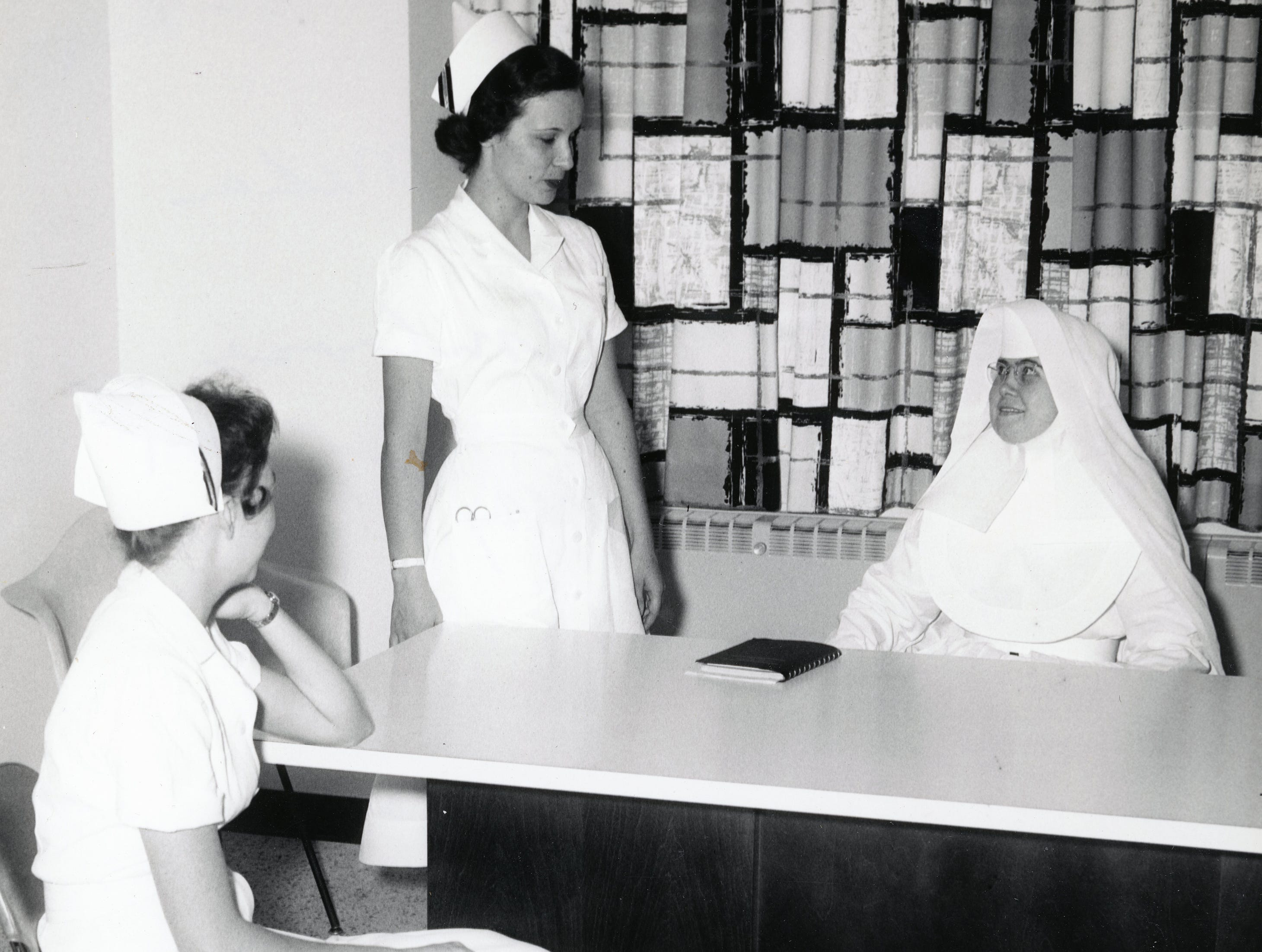 Peggy McMahan, Debra Ambrose and Sister Mary Elaine at St. Mary's Hospital in the 1950s.