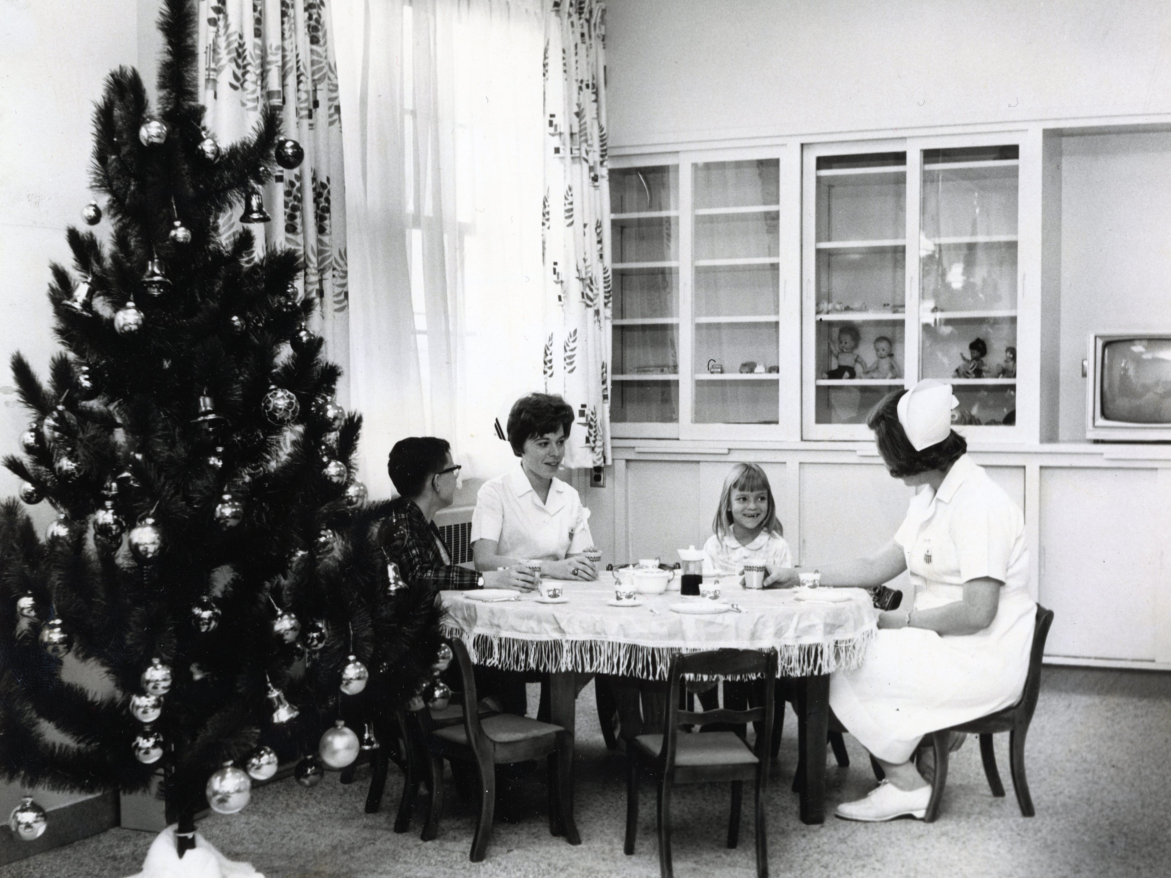 From left to right, Dan Hill, Mary Gail Jamieson, Lisa Kirby and Brenda Anderson at St. Mary's Medical Center's pediatric care unit in December 1966.